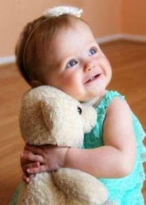 caring-baby-girl-214x300