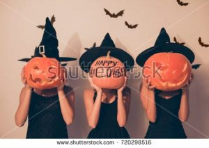 stock-photo-trick-or-treat-welcome-to-nightmare-three-mystical-ladies-worlocks-with-jackolanterns-in-black-720298516-1